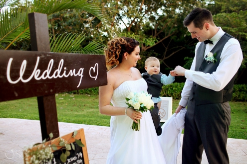 cute wedding photo baby fist bumps mom dad, wedding BlueBay Grand Esmeralda, Playa del Carmen, Mexico