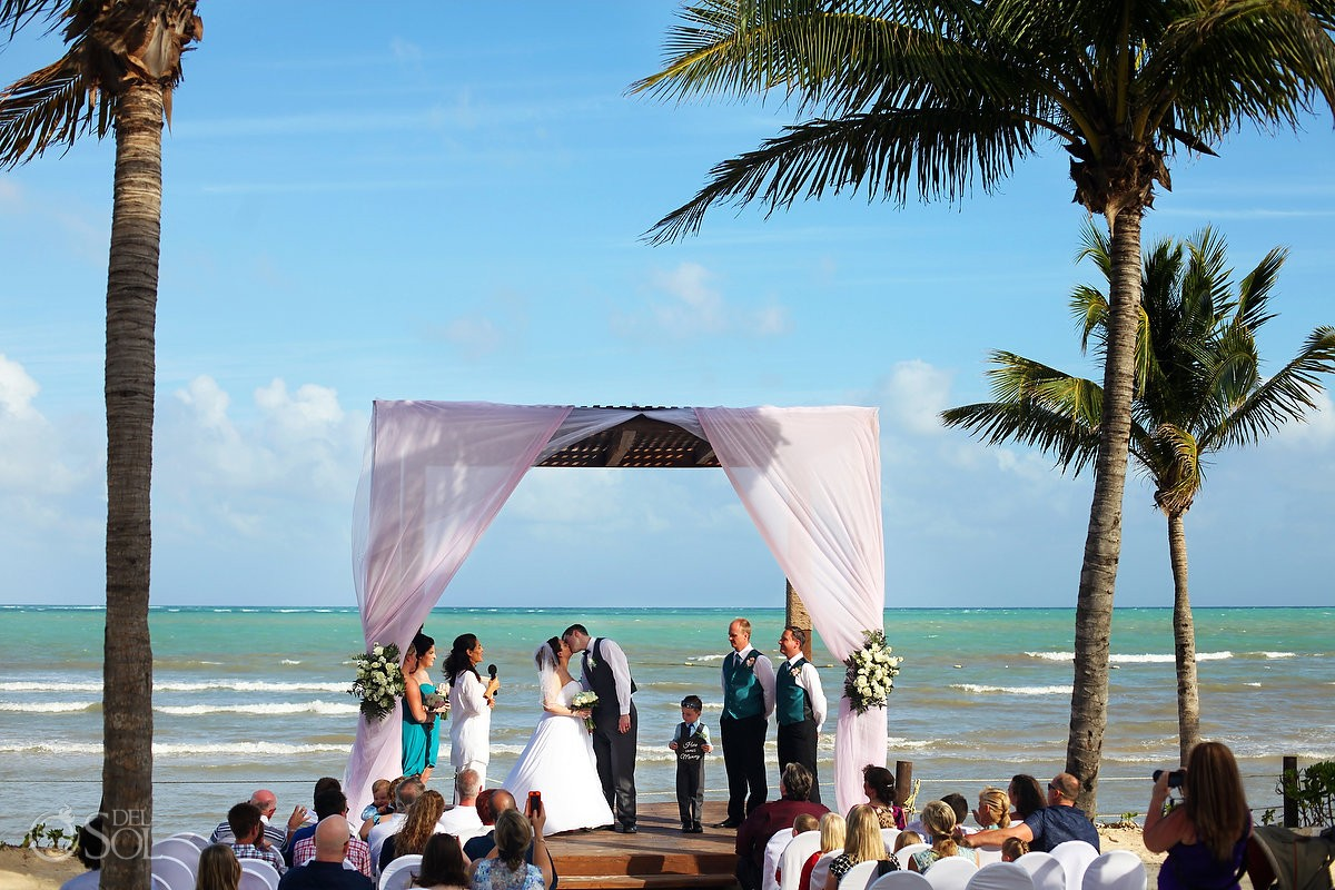 first kiss, beach wedding BlueBay Grand Esmeralda, Playa del Carmen, Mexico