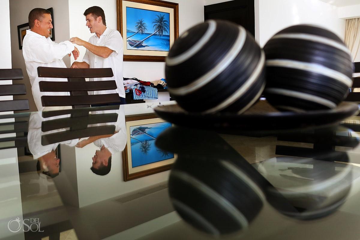 groomsman getting ready at Porto Fino Condominiums, Cancun