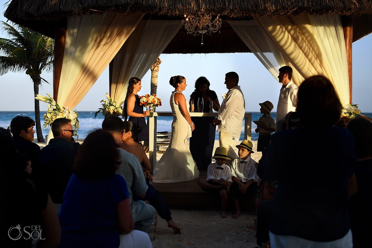 destination wedding photo of bride and groom stand at the alter in cancun mexico