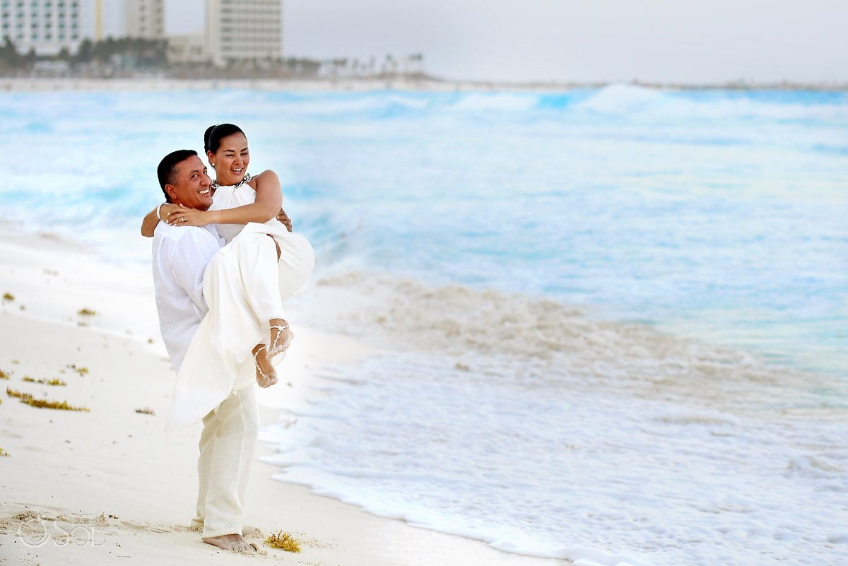 destination wedding photo of bride and groom on the beach in cancun mexico