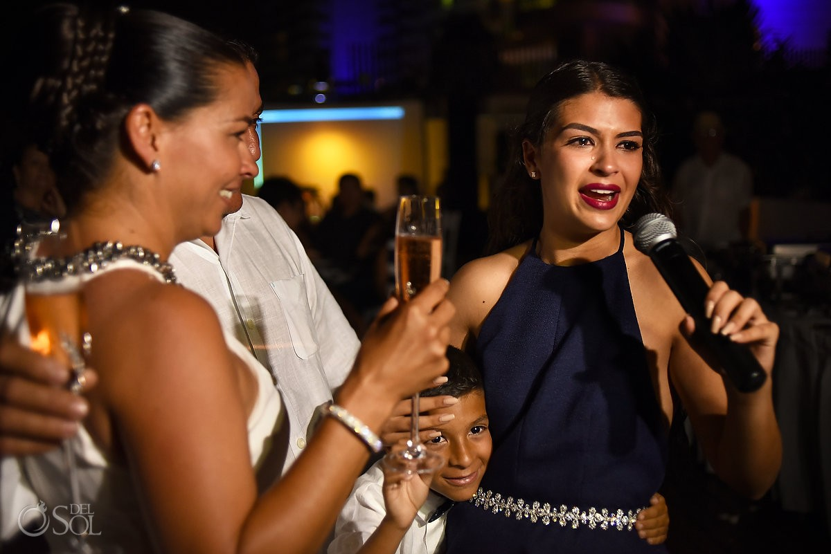 bride and bridesmaid cry during speeches at wedding reception