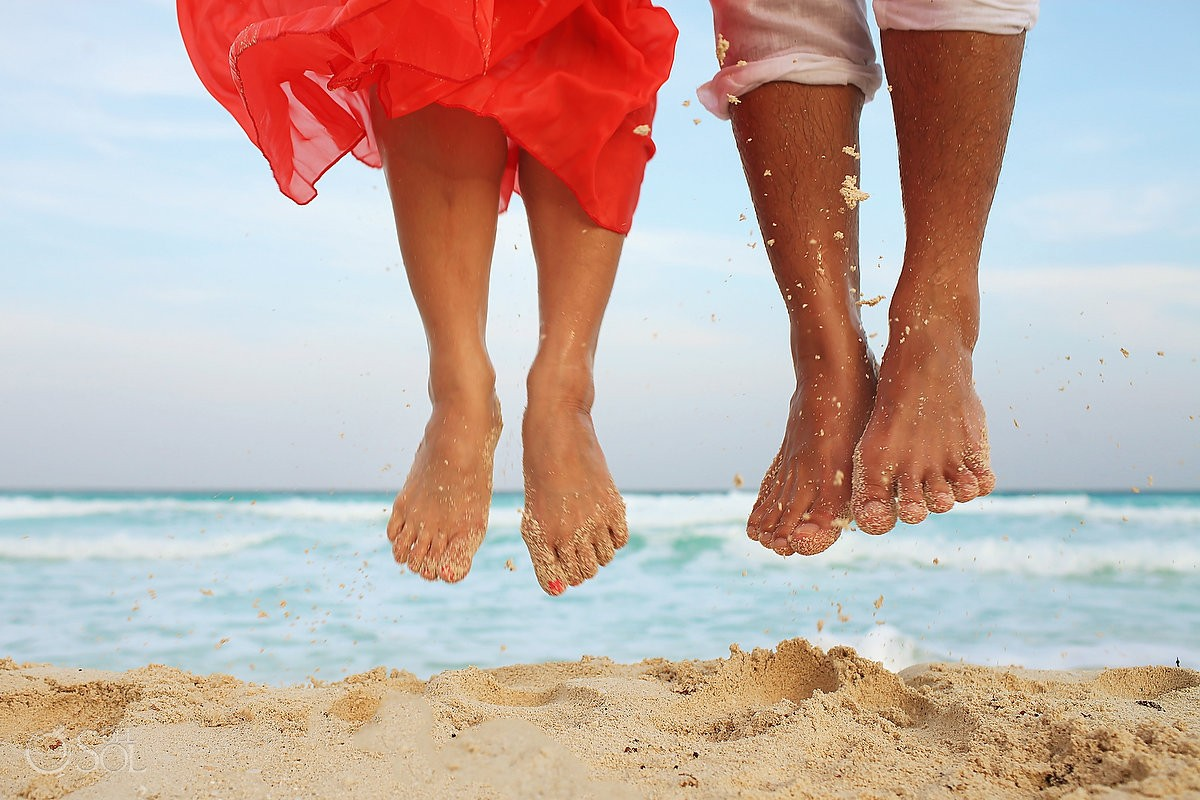 Feet in the sand in cancun jumping at the Casa Magna Marriott