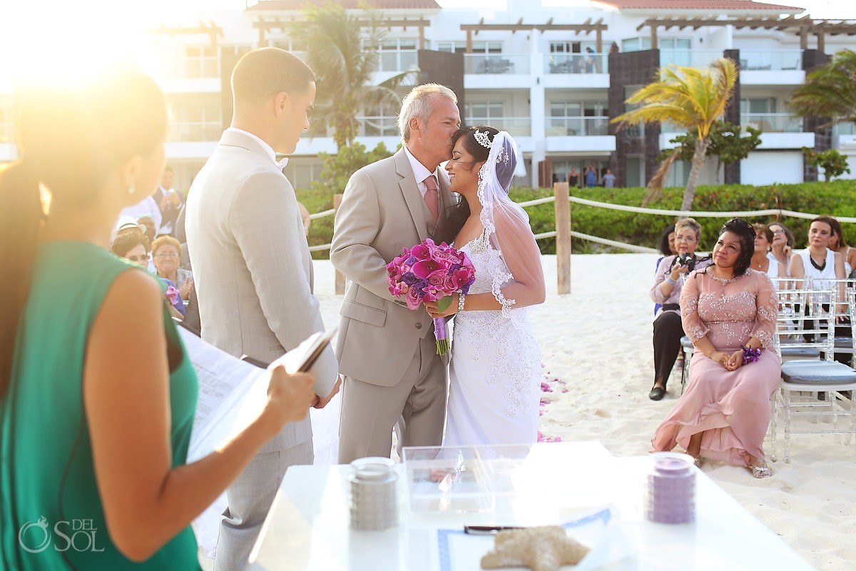 beautiful light wedding ceremony Grand Coral Beach Club bride entrance kiss