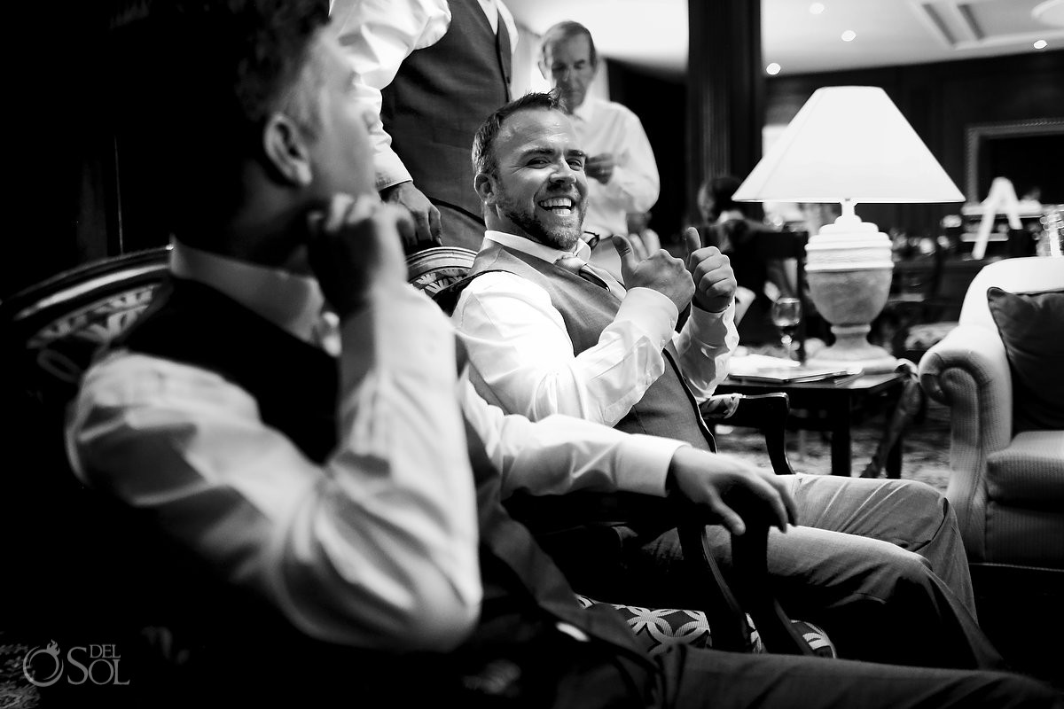 Groom getting ready candid black white wedding photo Now Sapphire Puerto Morellos, Mexico