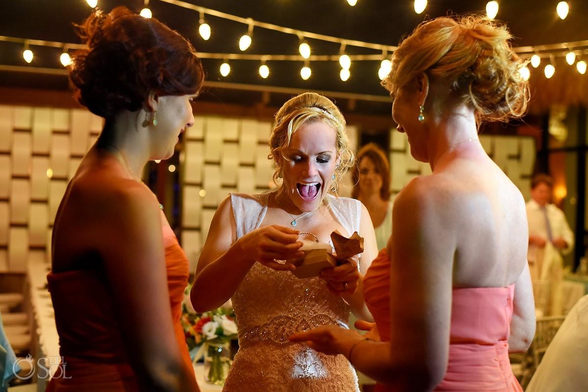 bride recieves gift destination wedding reception tequila terrace Now Sapphire Puerto Morellos, Mexico