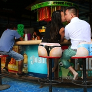 funny engagement portrait thong string bar stool 5th avenue playa del Carmen