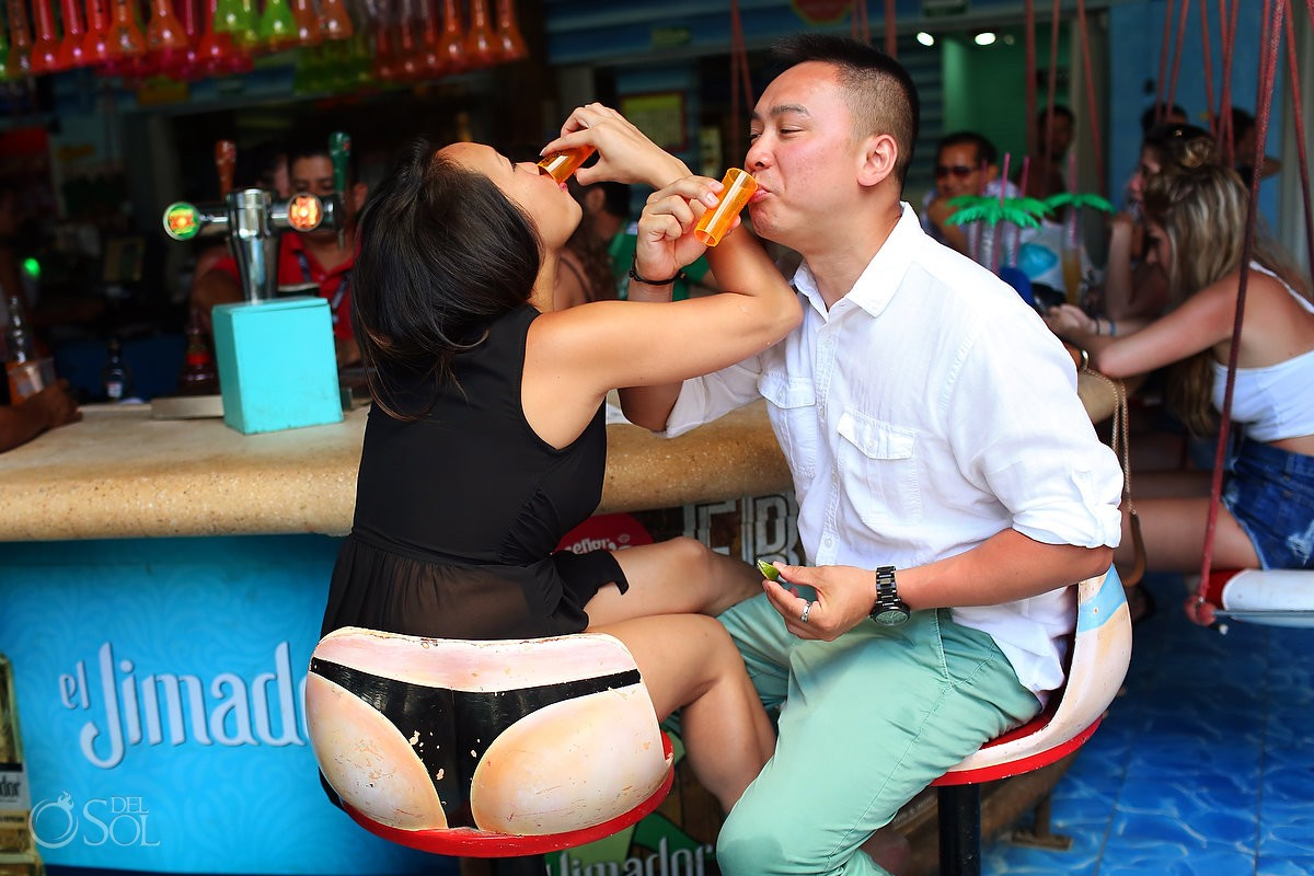 funny engagement portrait thong string bar stool tequila shots