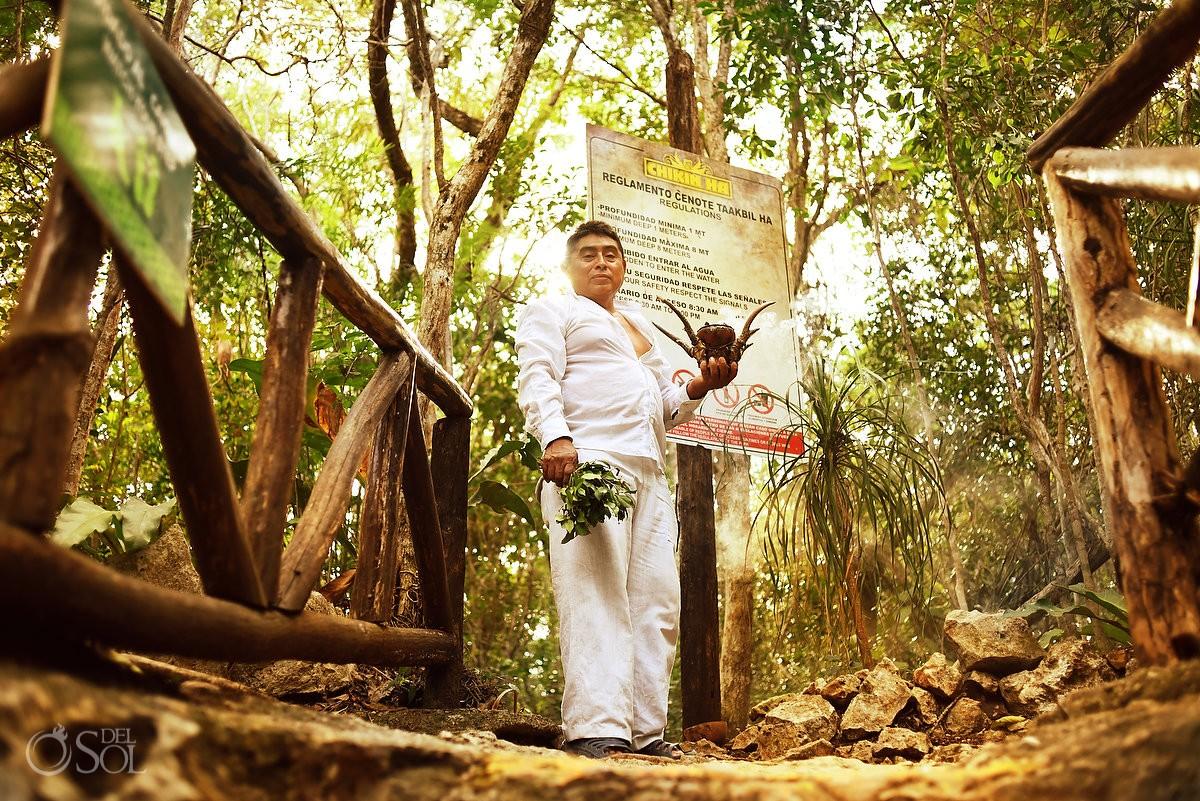 Shaman holding horn copal cenote chikin ha wedding