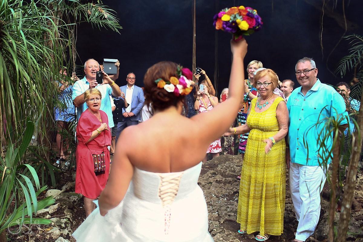 bride entering wedding ceremony cenote Chikin Ha guest cheering