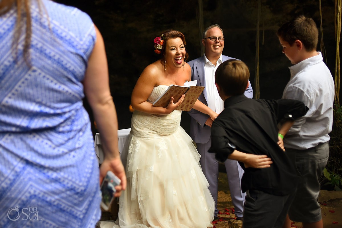 bride laughing wedding ceremony cenote Chikin Ha