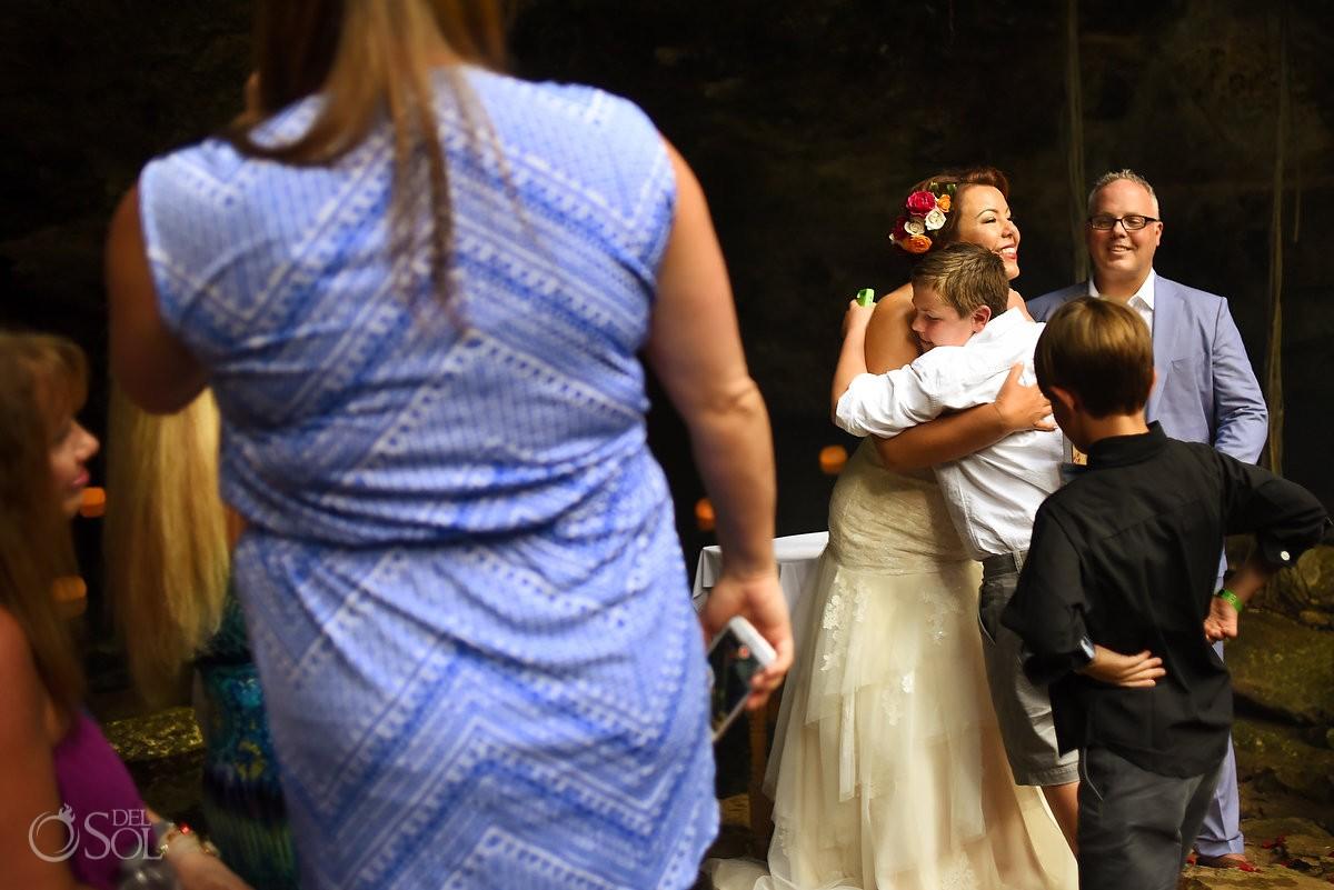 bride hugs step son, family love, Chikin Ha Cenote wedding, Riviera Maya, Mexico