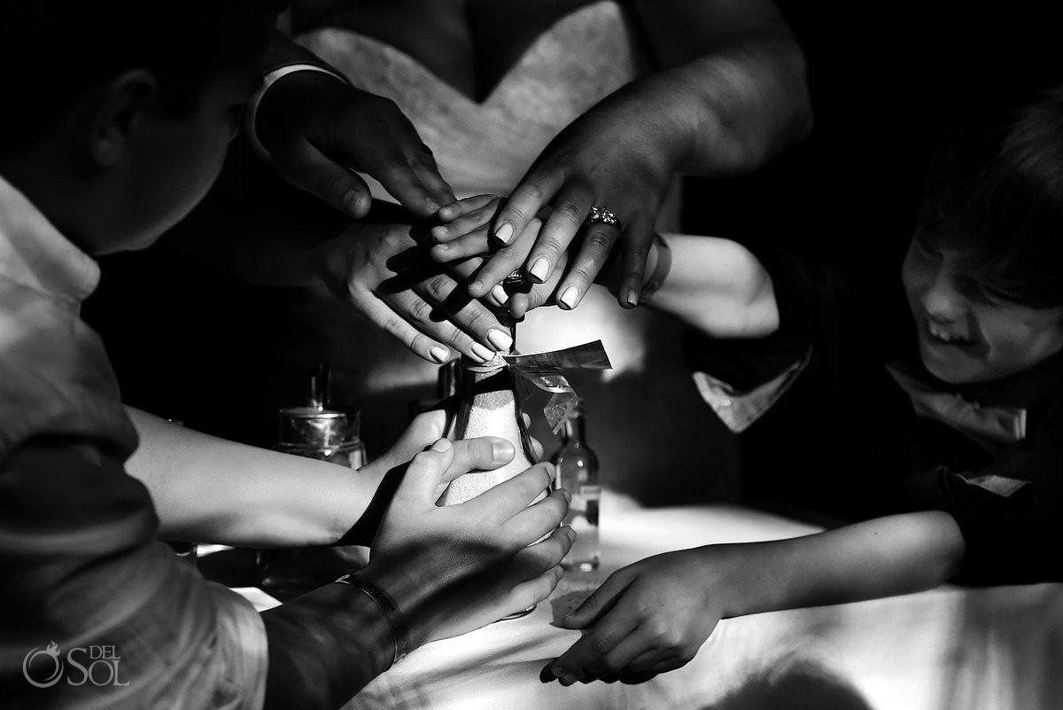 family sand ceremony hands detail black white