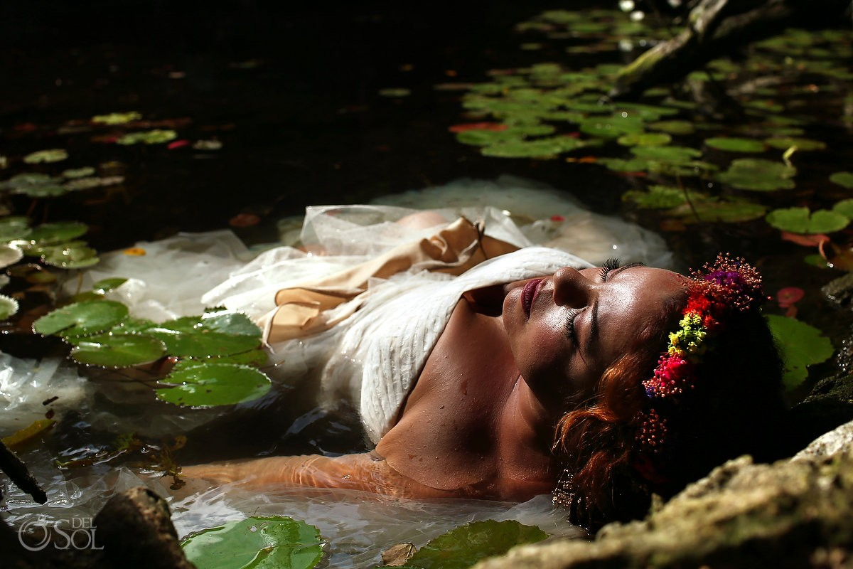 ophelia bride flower crown lying in water liy pads cenote trash the dress Mexico