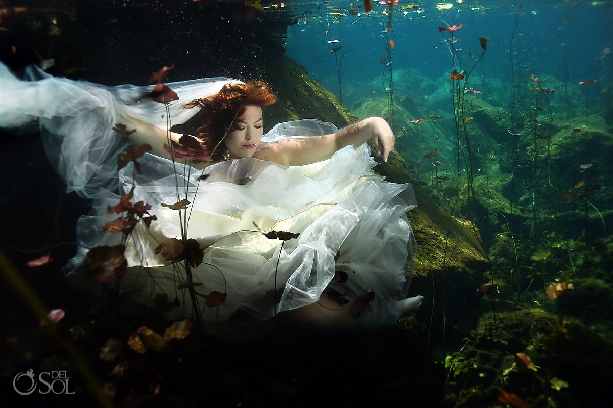 underwater bride cenote trash the dress photo
