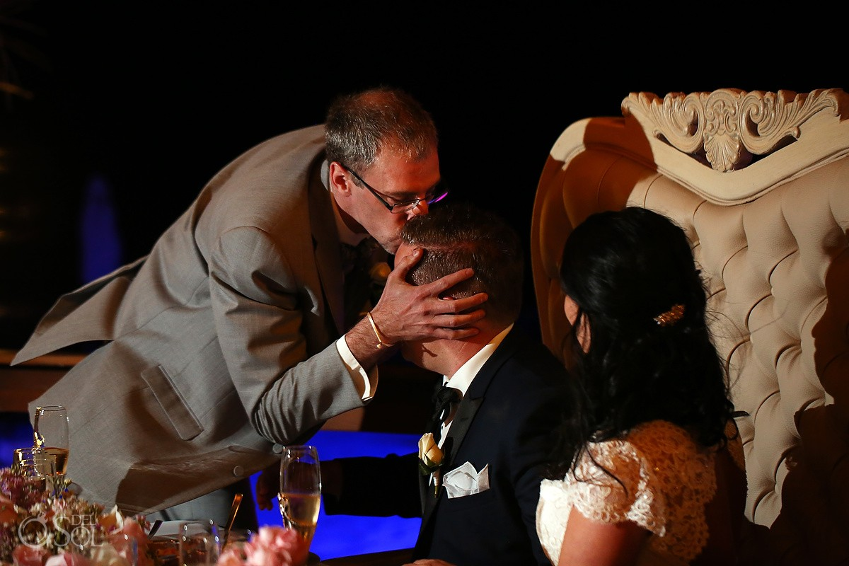 father groom kisses head wedding reception Royalton Riviera Maya Nautica Beach Bar