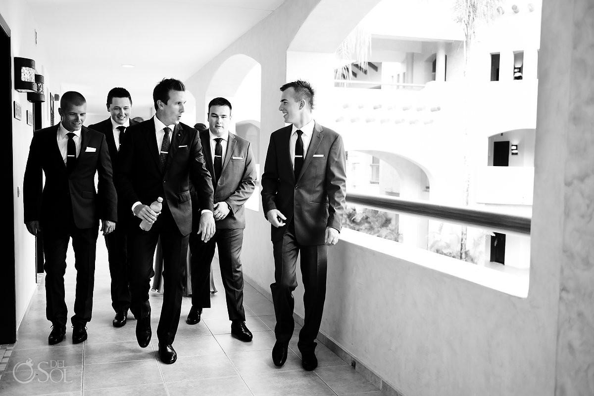 groom groomsmen candid walking black white photograph Destination Wedding Barceló Maya Palace