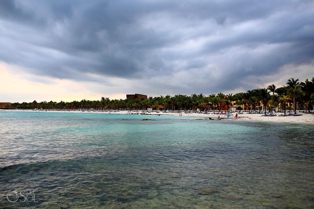 storm clouds over beach rain Destination Wedding Barceló Maya Palace