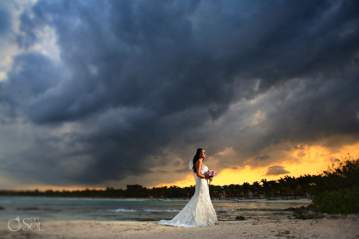 Dramatic beach bridal bride portrait, sunset after rain, Destination Wedding Barcelo Maya Palace Deluxe