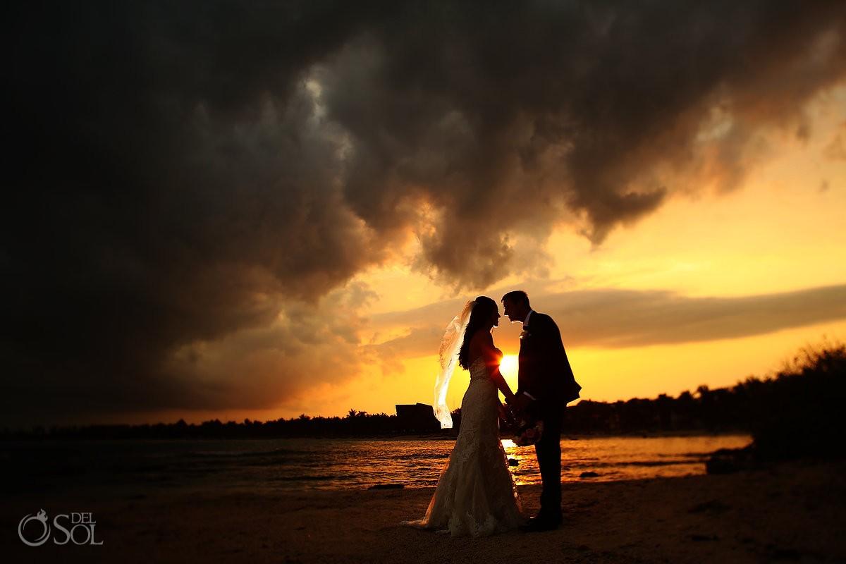 Dramatic sunset after rain Destination Wedding portrait silhouette Barcelo Maya Palace Deluxe beach