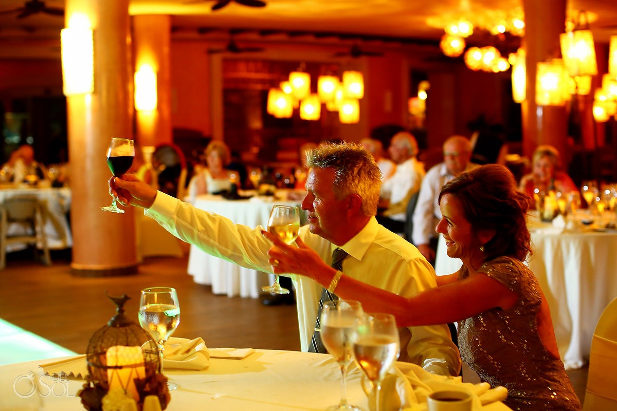 toasts cheers Destination Wedding reception Barcelo Maya Palace Deluxe Goral Grill