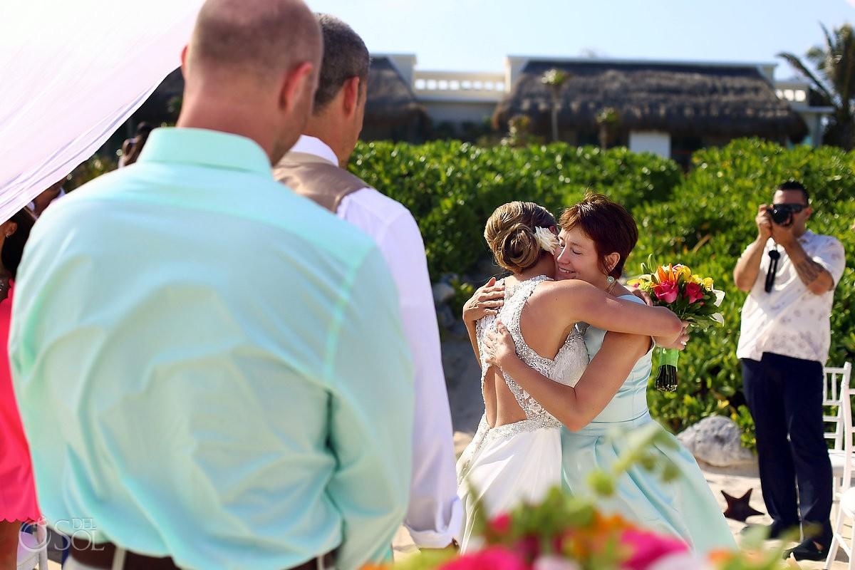 bride entrance mom hug beach wedding Valentin Imperial Maya beach, Playa del Carmen
