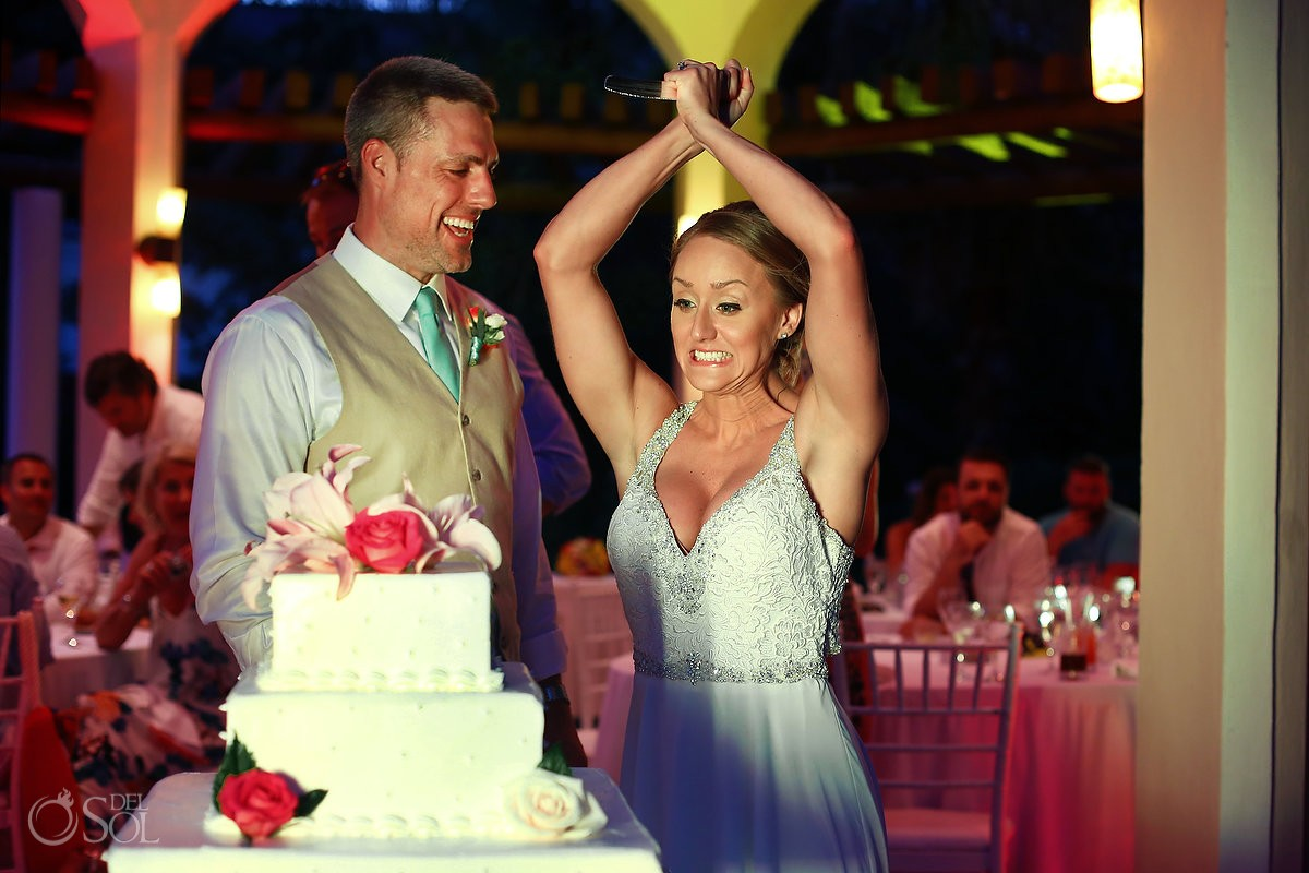 funny wedding photo cake cutting bride stabs cake with knife reception Valentin Imperial Maya Gazebo