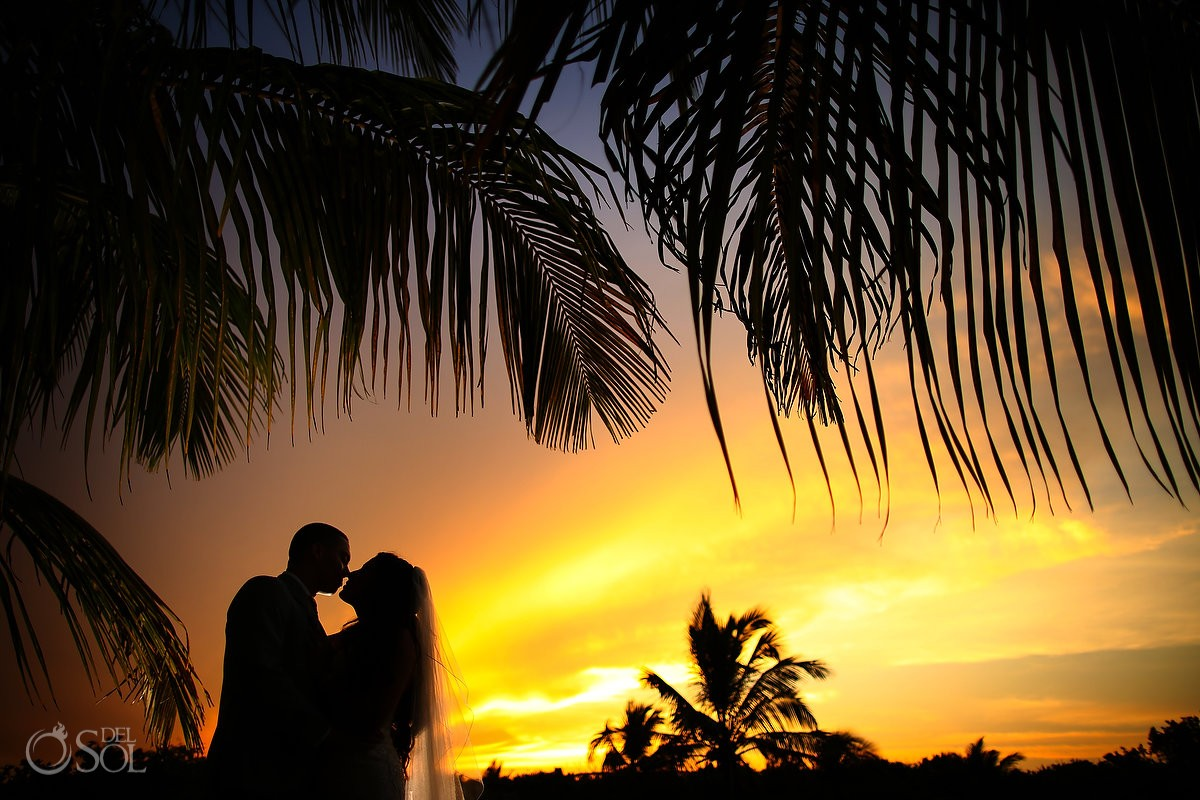 sunset destination wedding portrait silhouette palm tree Blue Venado Beach Club, Playa del Carmen, Mexico