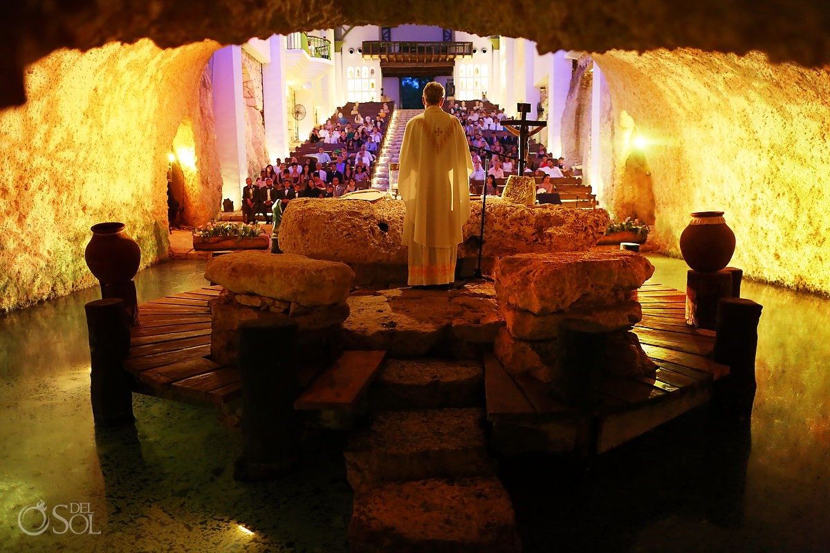Catholic Mass underground cenote church chapel of Guadalupe Xcaret, Riviera Maya, Mexico