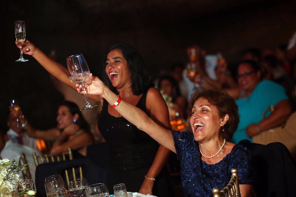 wedding reception guests cheering toast La Isla Restaurant Xcaret, riviera maya, Mexico