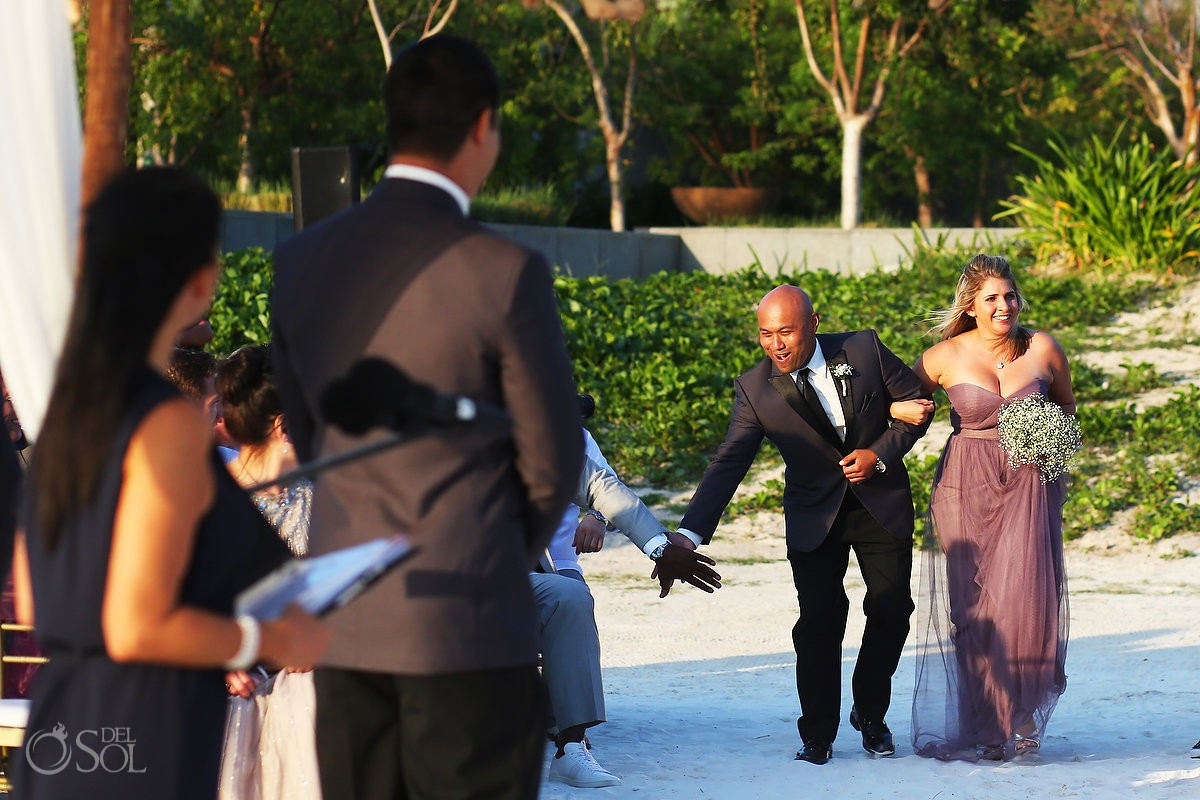 fun destination wedding photo processional groomsman high five, Beach ceremony NIZUC Resort, Cancun