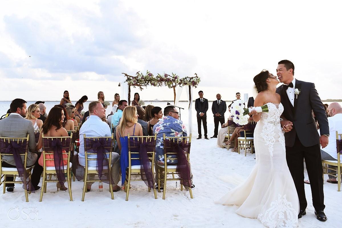 funny ceremony exit celebration Destination Beach Wedding NIZUC Resort, Cancun