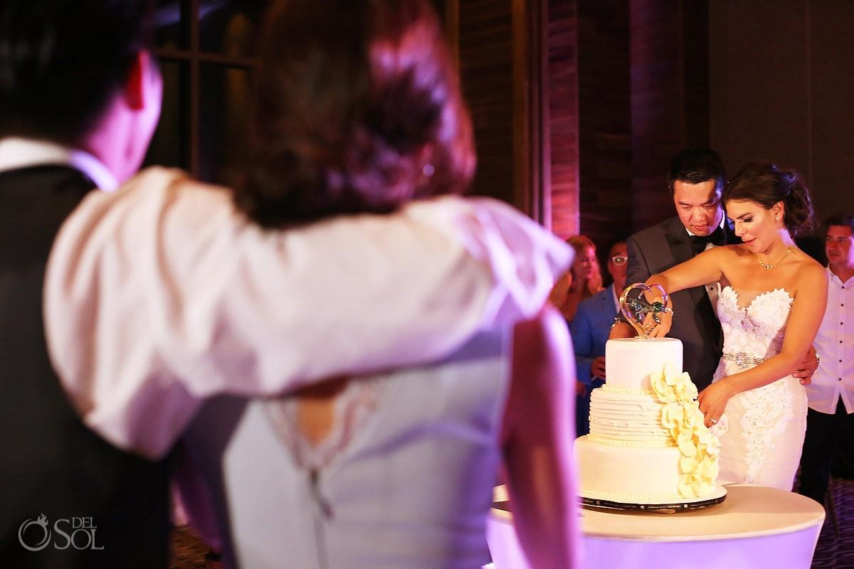 Cake cutting Destination Wedding reception Nizuc ballroom Cancun