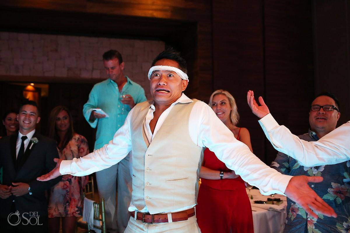 funny garter toss Destination Wedding reception Nizuc ballroom Cancun