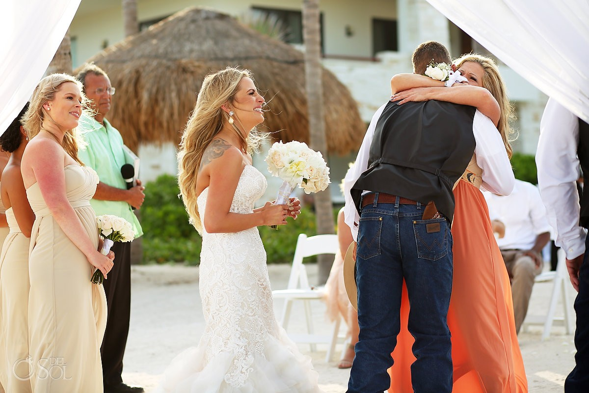 hugs after wedding ceremony, family love, beach destination wedding, Secrets Akumal, Riviera Maya, Mexico