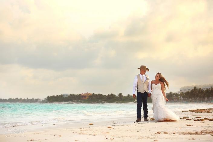 walking beach destination wedding portrait, groom wearing cowboy hat, Secrets Akumal, Riviera Maya, Mexico