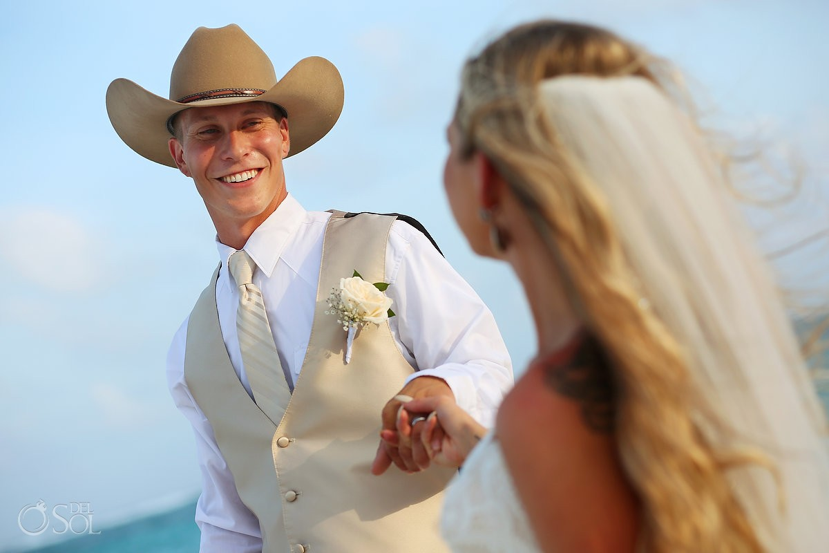 groom wearing cowboy hat smiling, destination wedding portrait, Secrets Akumal, Riviera Maya, Mexico