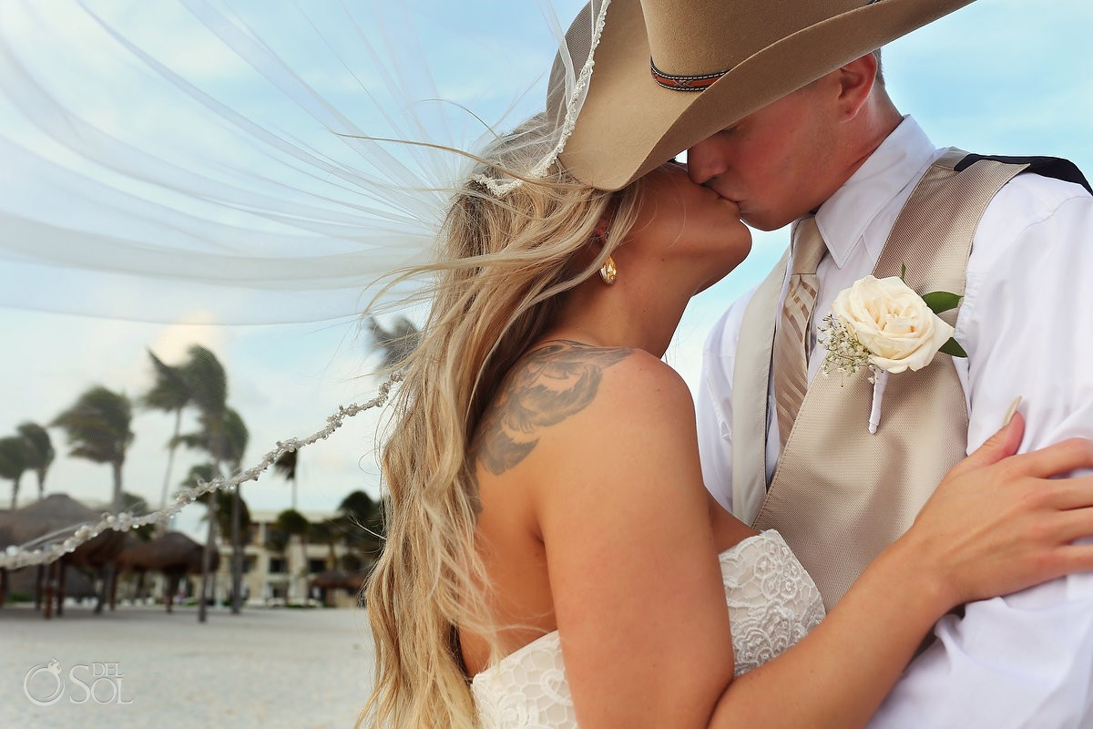 romantic kiss beach destination wedding portrait, groom wearing cowboy hat, Secrets Akumal, Riviera Maya, Mexico