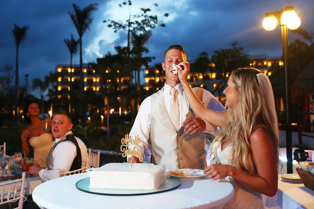 funny wedding cake smash photograph, reception secrets Akumal, riviera Maya, Mexico