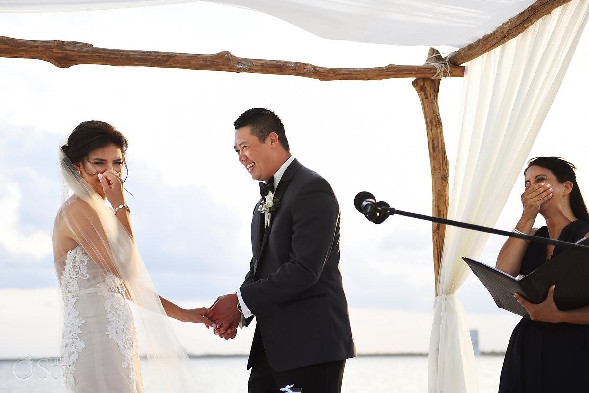 bride groom officient laughing Destination Beach Wedding NIZUC Resort, Cancun