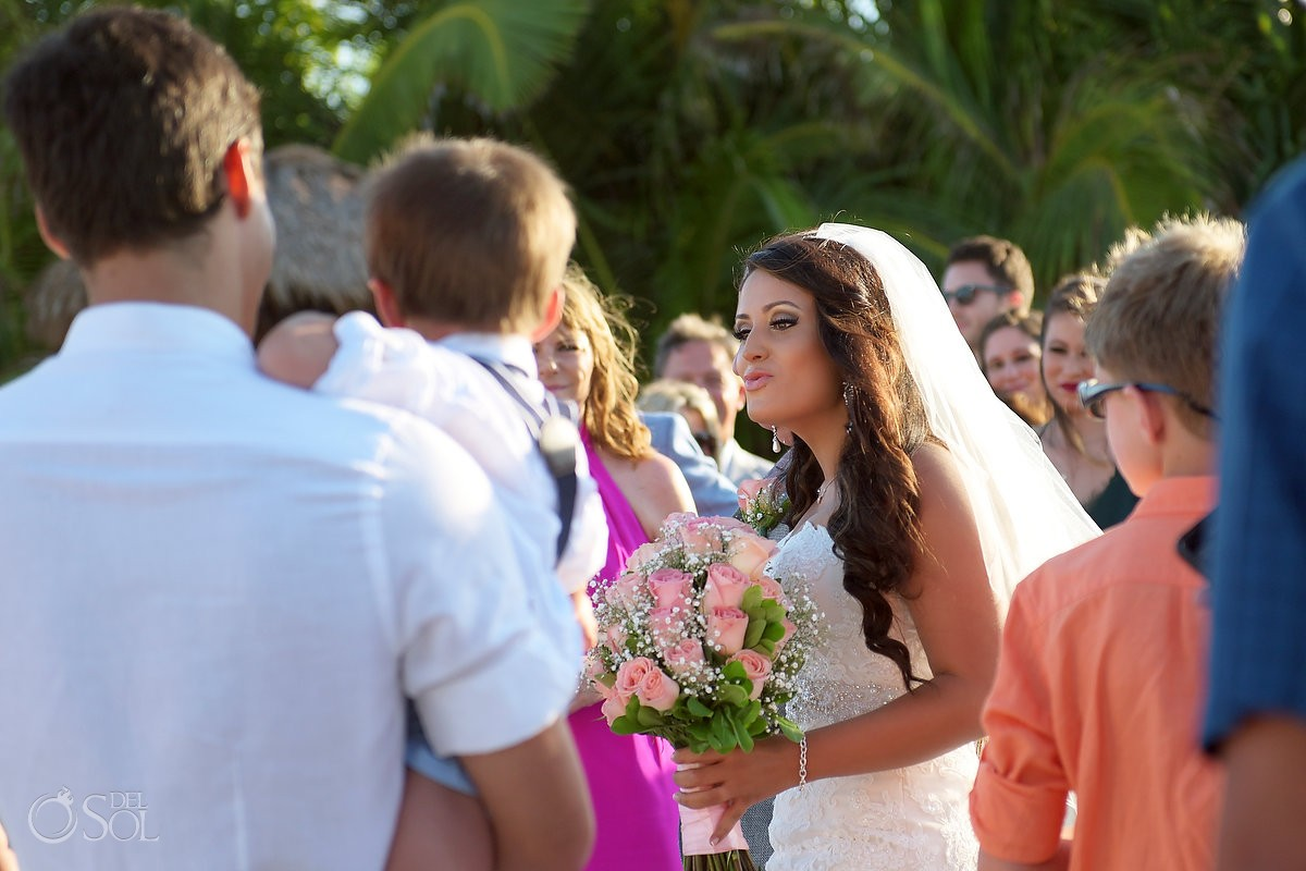 Bride blows kiss at son, destination wedding Blue Venado Beach Club, Playa del Carmen, Mexico