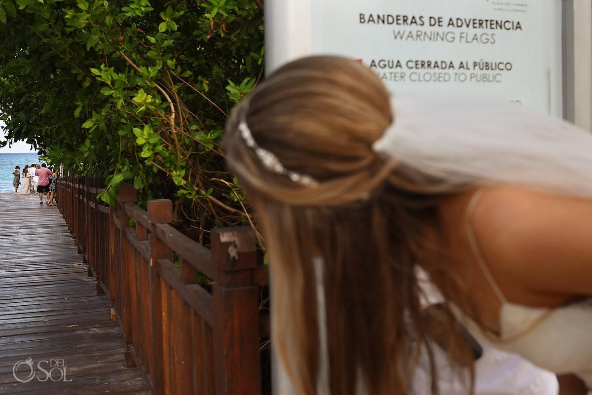 bride peeking down gabi bridge at Paradisus playa del carmen mexico