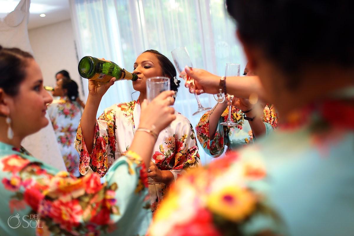 fun getting ready photo bride swigging drinking champagne from bottle, getting ready Paradisus La Esmeralda, Playa del Carmen, Mexico