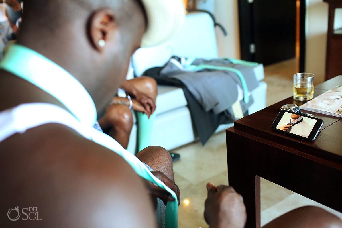 funny Wedding Photo, groomsman watching video how to tie getting ready Paradisus La Esmeralda, Playa del Carmen, Mexico