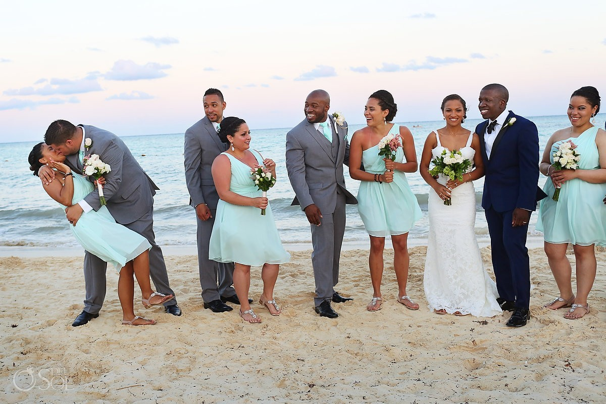 funny candid wedding picture groomsman kiss bridesmaid Beach portrait Gabi Bridge Paradisus, Playa del Carmen, Mexico