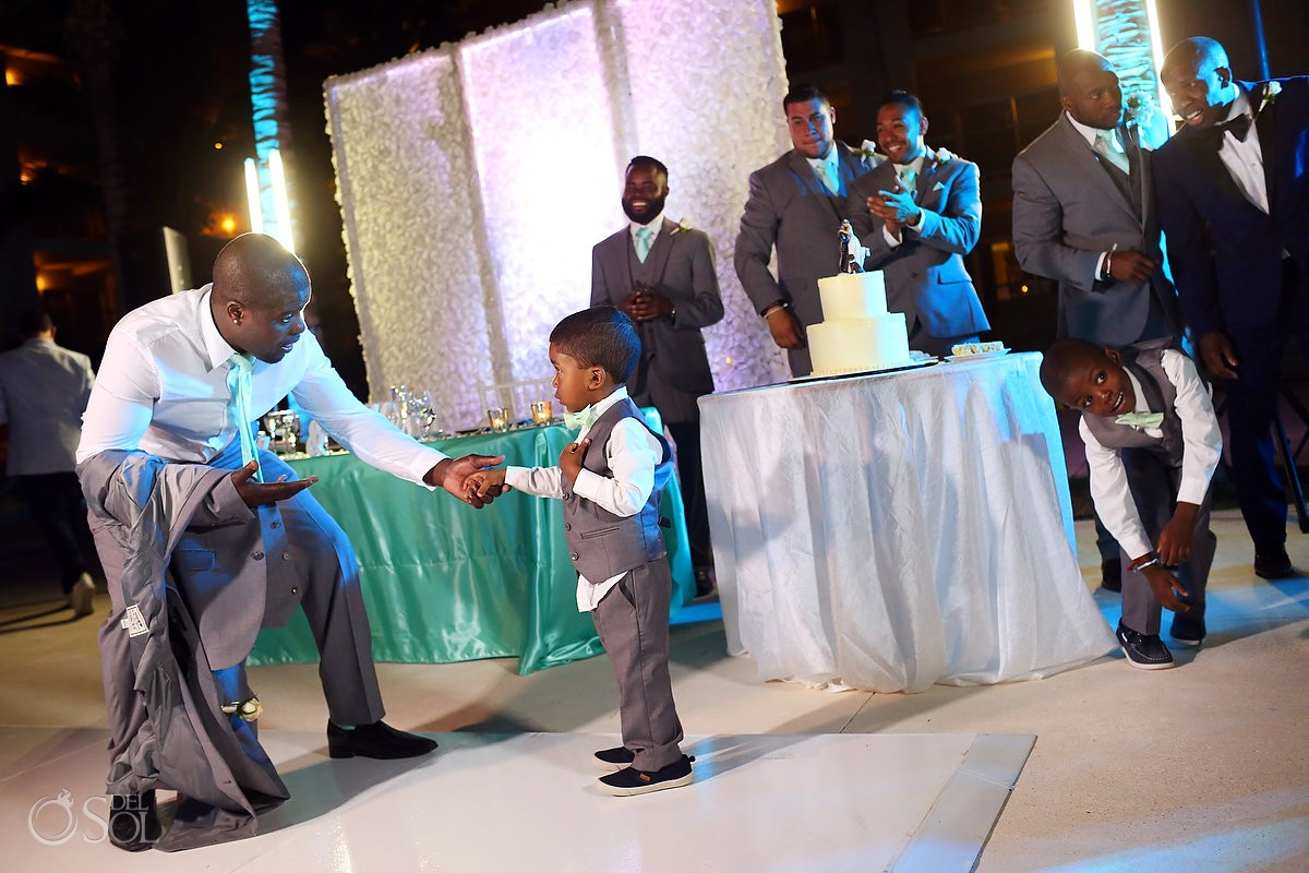 cute kid cake cutting destination wedding reception entrance Paradisus La Esmeralda, Playa del Carmen, Mexico