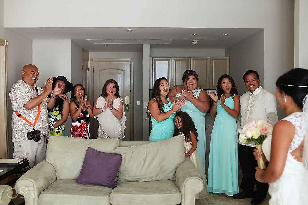 candid wedding photo, family bridal party see bride dress first time, Sandos Cancun