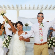 happy celebration, ceremony exit destination wedding Sandos Luxury Cancun rooftop