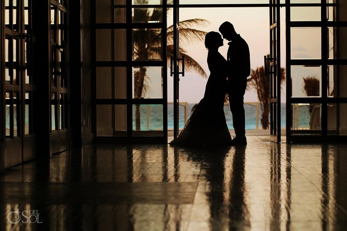 Sunset destination wedding portrait silhouette Sandos Luxury Cancun Mexico