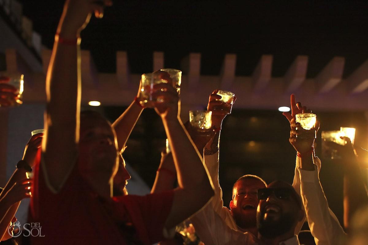toast cheers destination wedding reception Sandos Luxury Cancun rooftop